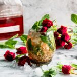 mint julep in a glass with mint and roses