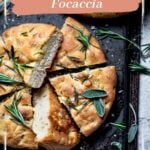 Focaccia sliced and covered with herbs