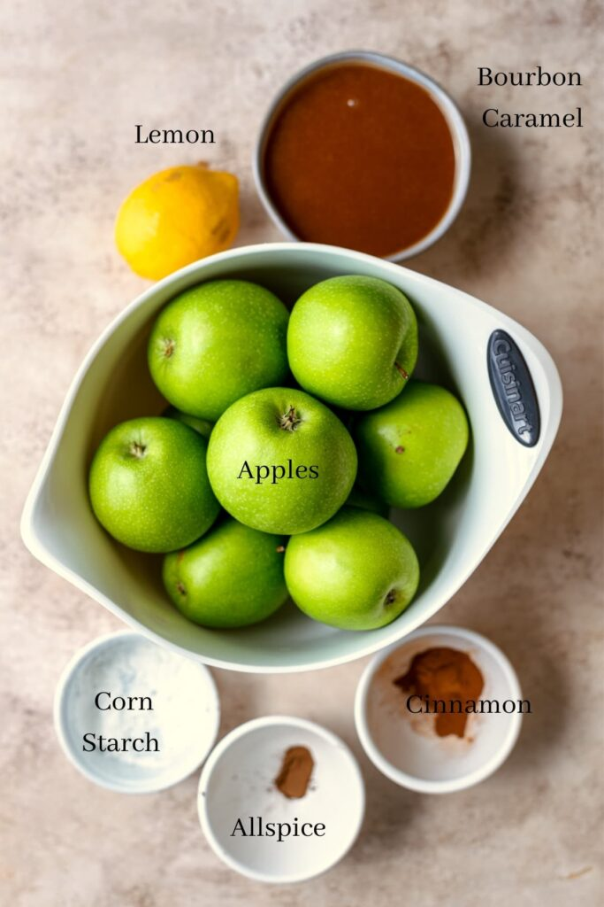 Ingredients for the apple filling on a brown table
